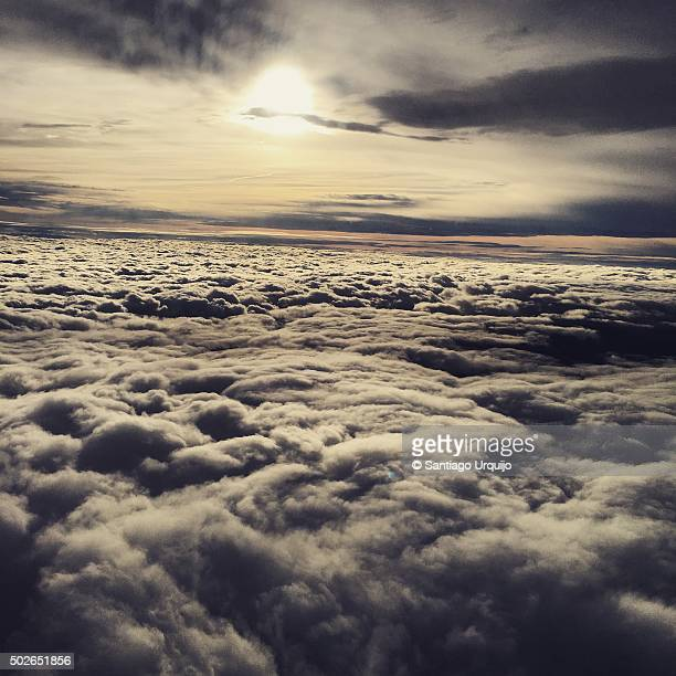 High angle view of sky above clouds