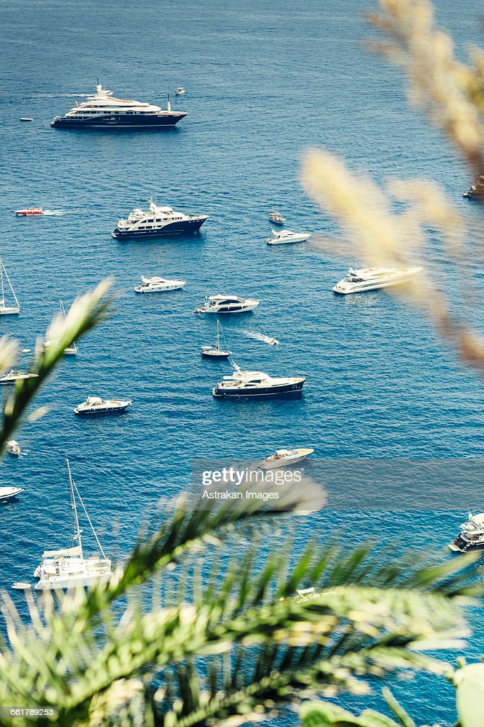 High angle view of small boats sailing in sea