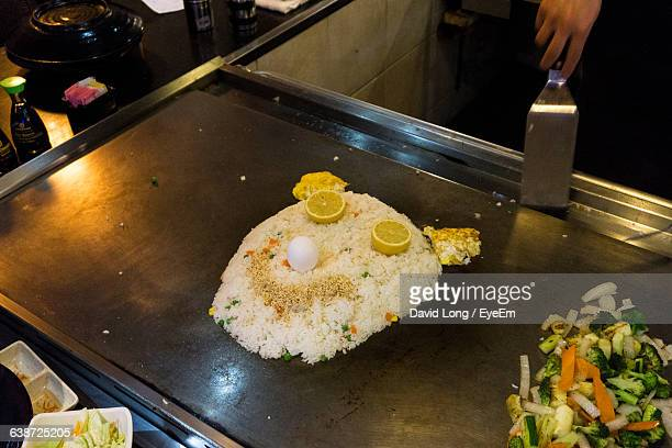 High Angle View Of Smiley Face Made From Rice Meal On Kitchen Counter