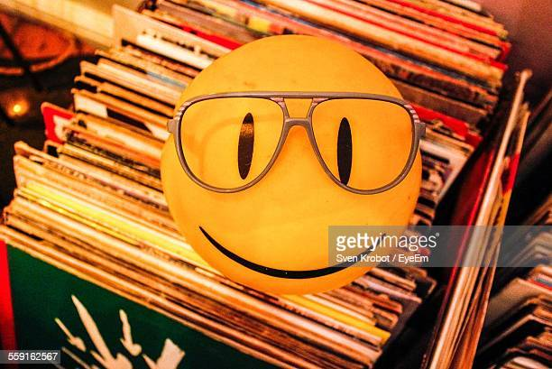 High Angle View Of Smiley Face With Eyeglasses At Home
