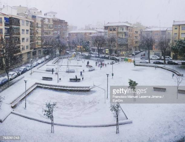 High Angle View Of Snow Covered Park In City During Snowfall