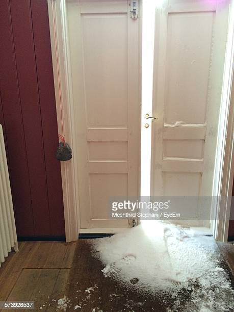 High Angle View Of Snow On Floor At Doorway