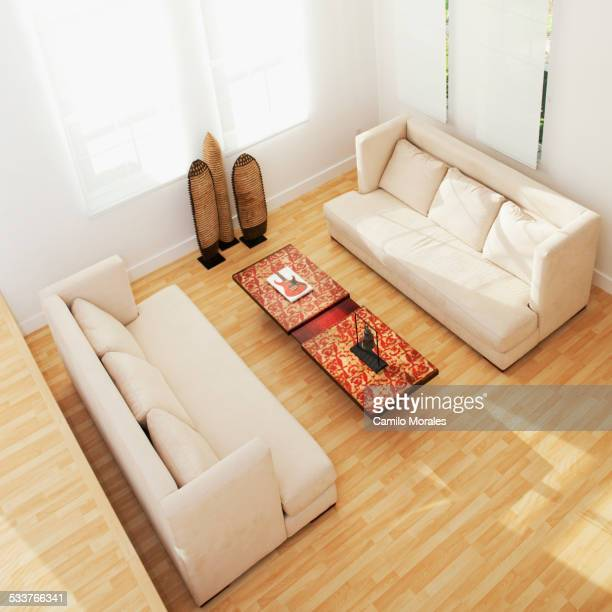 High angle view of sofas and coffee table in modern living room