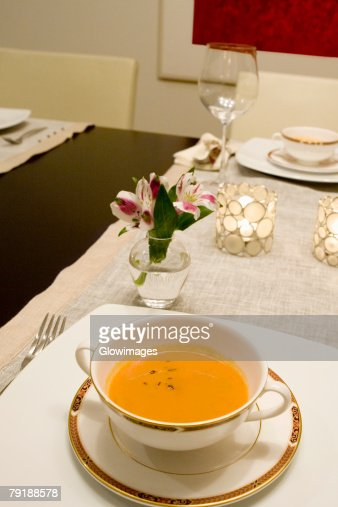 High angle view of soup in a bowl on a dining table : Foto de stock