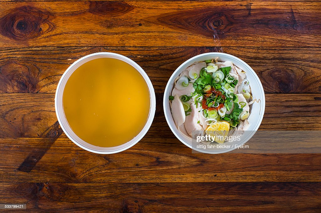 High Angle View Of Soup With Ham Dish On Serving Table