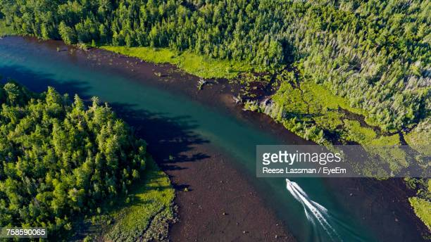 High Angle View Of Speedboat On River Amidst Trees