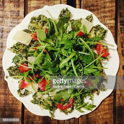 High Angle View Of Spinach Dumplings With Salad In Plate On Table