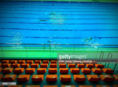 High angle view of sportsmen swimming in pool at stadium