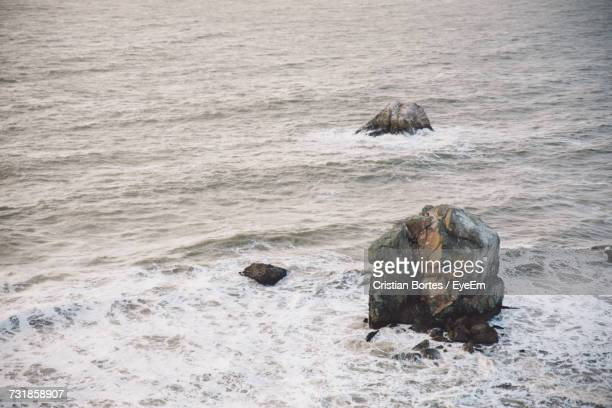 High Angle View Of Stack Rocks In Sea