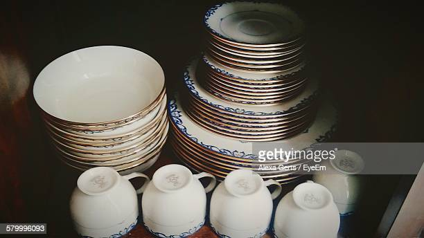 High Angle View Of Stacked Ceramics In Shelf