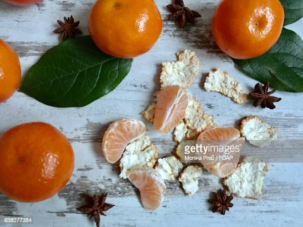High angle view of star anise and oranges