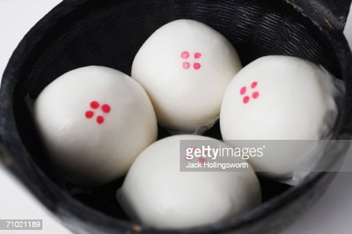 High angle view of steamed dumplings in a basket : Stock Photo