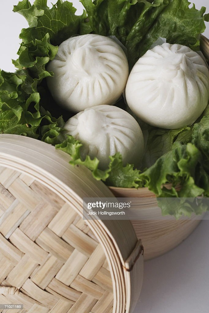 High angle view of steamed dumplings in a steamer : Stock Photo