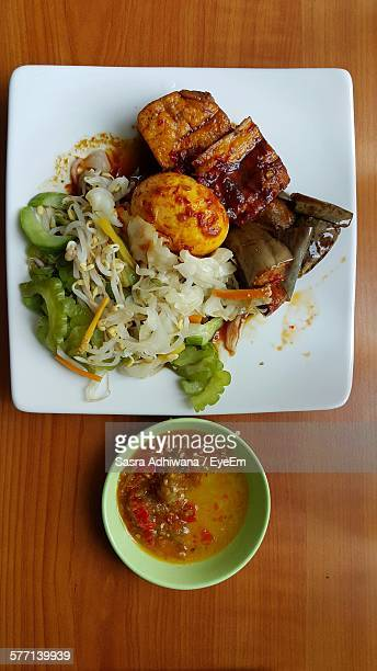 High Angle View Of Stewed Vegetables On Plate With Sauce