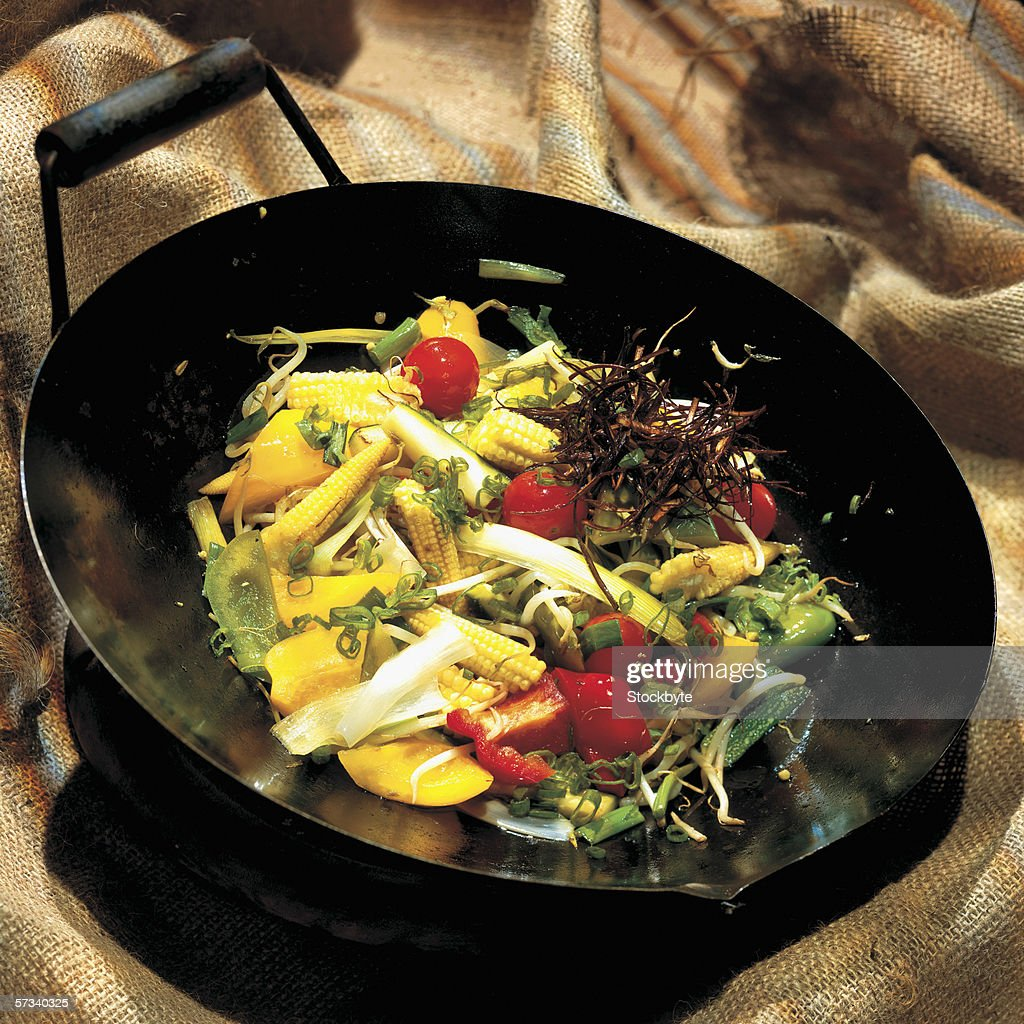 high angle view of stir fried vegetables in a wok : Stock Photo
