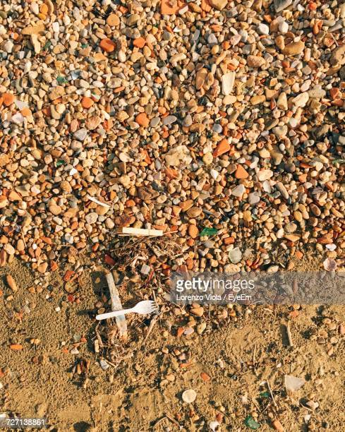 High Angle View Of Stones At Beach On Sunny Day