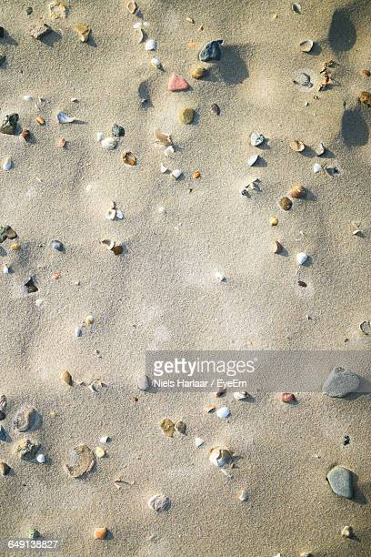 High Angle View Of Stones On Shore At Beach