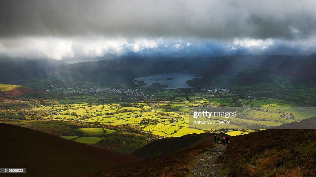High Angle View Of Storm Clouds Over Green Landscape