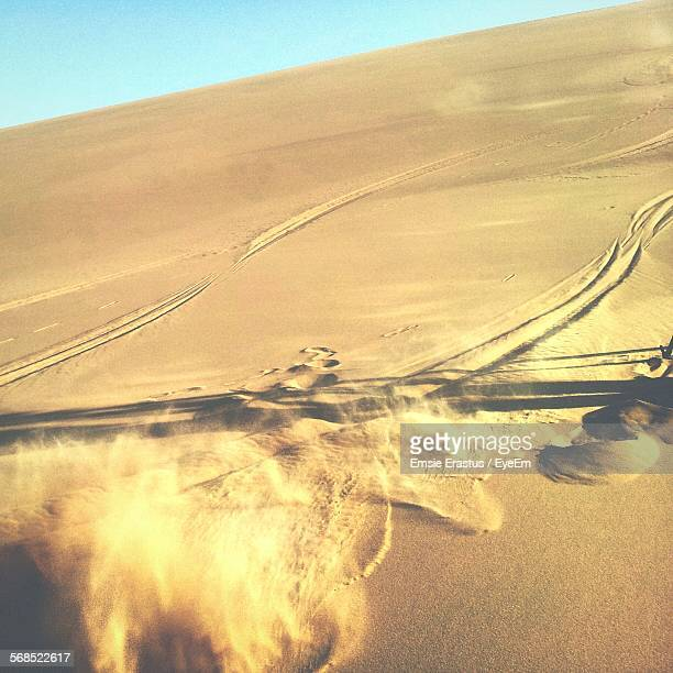 High Angle View Of Storm On Sand In Desert