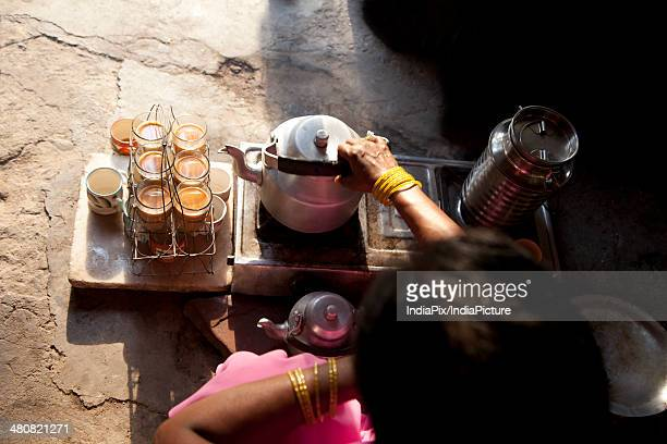 High angle view of street vendor making tea at stall
