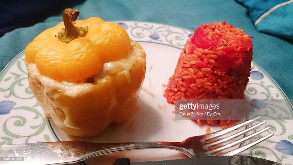High Angle View Of Stuffed Bell Pepper With Rice Served In Plate On Table