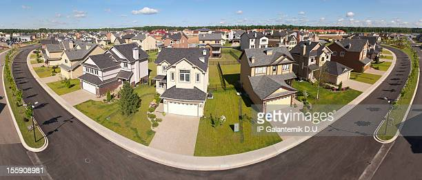 High angle view of suburban houses along a curving street