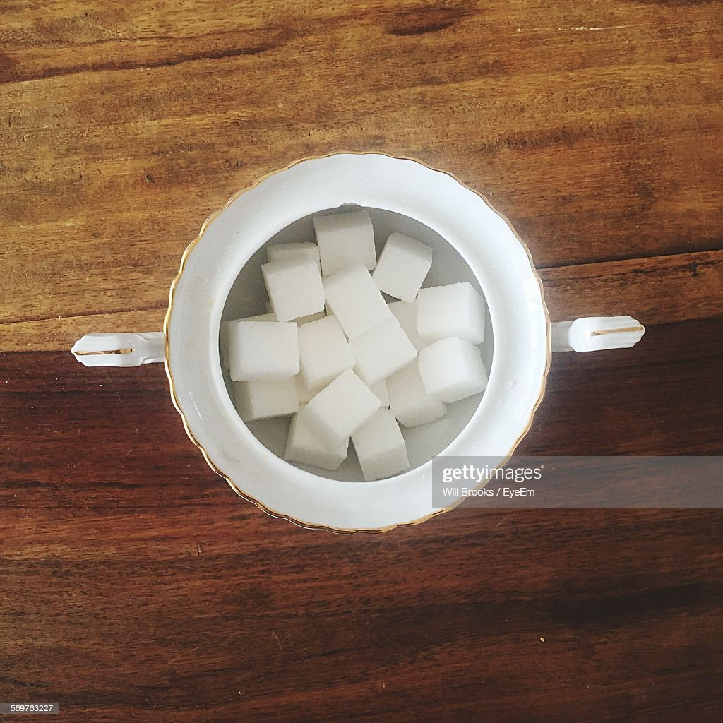 High Angle View Of Sugar Cubes In Bowl On Table