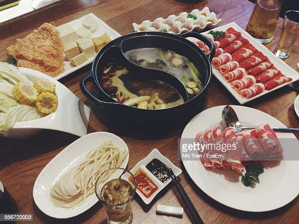 High Angle View Of Sukiyaki Served On Table
