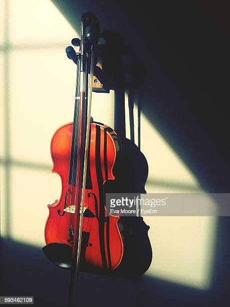 High Angle View Of Sunlight Falling On Violin Against Sky
