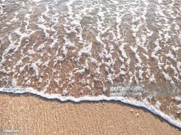 High Angle View Of Surf On Beach