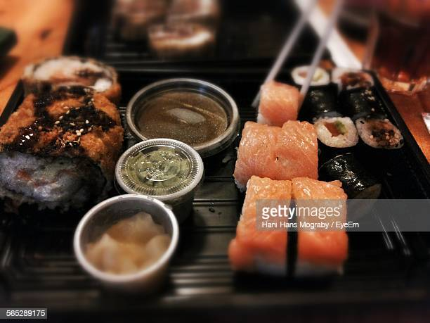 High Angle View Of Sushi And Sauces On Table