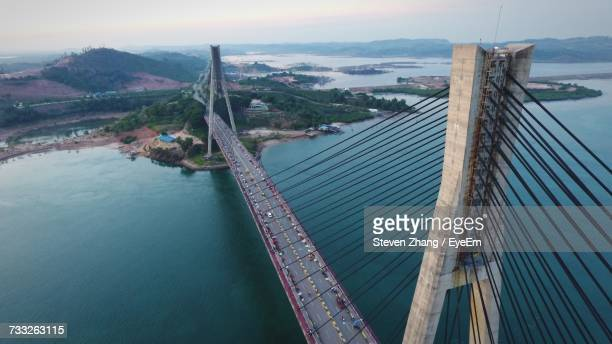 High Angle View Of Suspension Bridge Over River