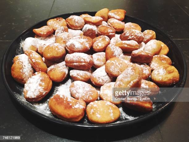 High Angle View Of Sweet Food With Flour In Plate On Floor
