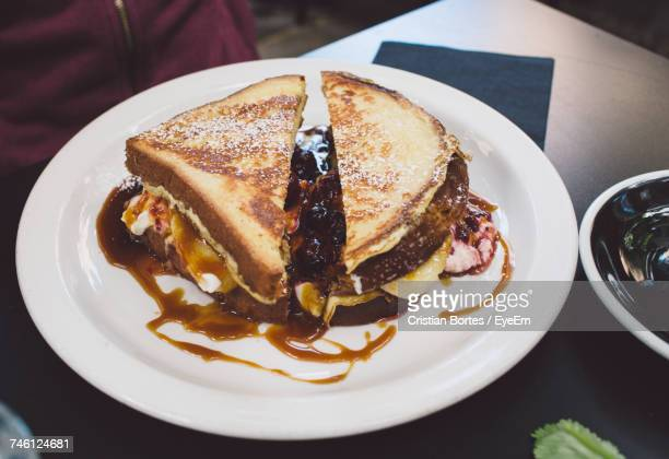 High Angle View Of Sweet Sandwich Served In Plate On Table