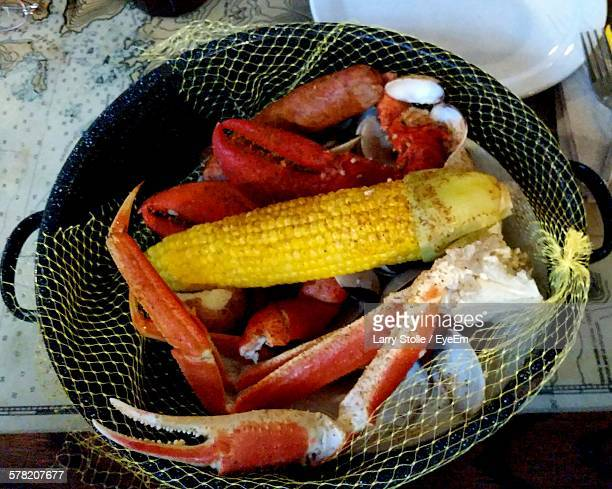 High Angle View Of Sweetcorn With Crabs On Table