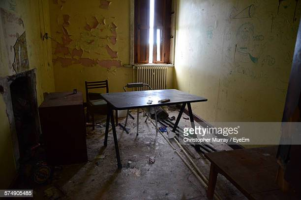 High Angle View Of Table In Abandoned Room