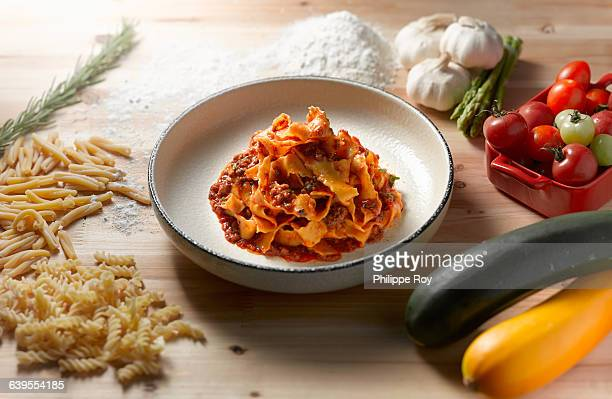 High angle view of tagliatelle bolognese in shallow bowl