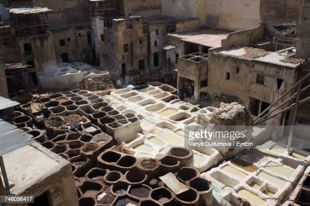 High Angle View Of Tannery Amidst Houses In City On Sunny Day