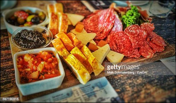 High Angle View Of Tapas On Cutting Board