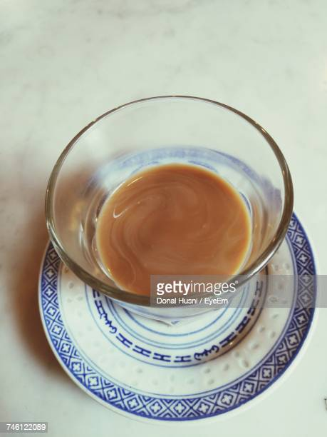 High Angle View Of Tea In Drinking Glass On Saucer