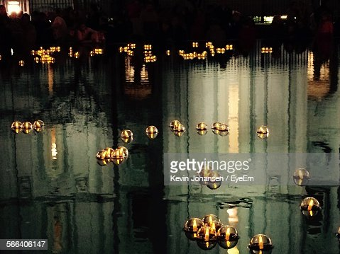 High Angle View Of Tea Light Candles Floating In River