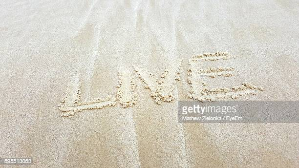 High Angle View Of Text At Sandy Beach