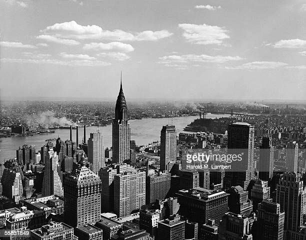 High angle view of the East Midtown skyline looking across the East River towards Queens and Brooklyn New York New York 1930s or 1940s Prominant...