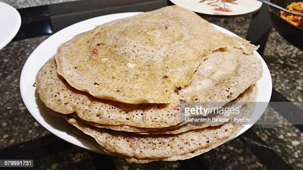 High Angle View Of Thosai In Plate On Table