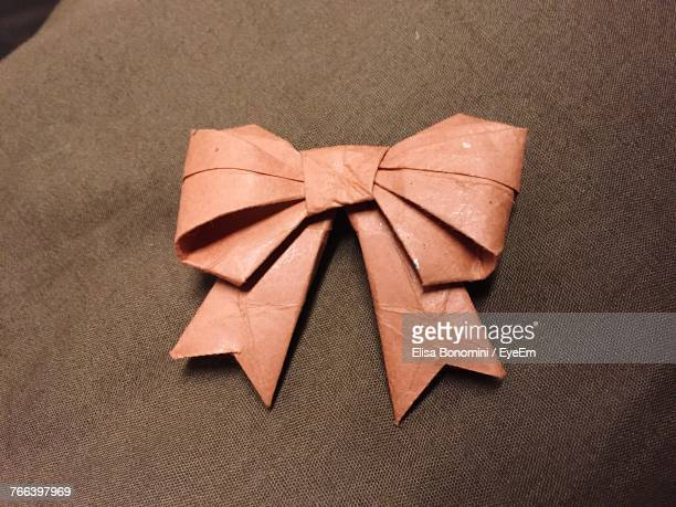 High Angle View Of Tied Bow On Bed
