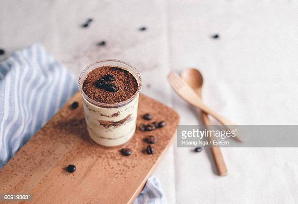 High Angle View Of Tiramisu On Wood At Table