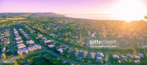 High Angle View Of Town Against Sky During Sunset