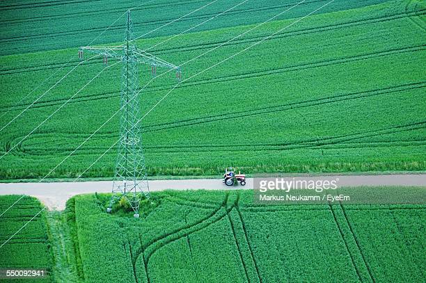 High Angle View Of Tractor On Road Amidst Agricultural Landscape