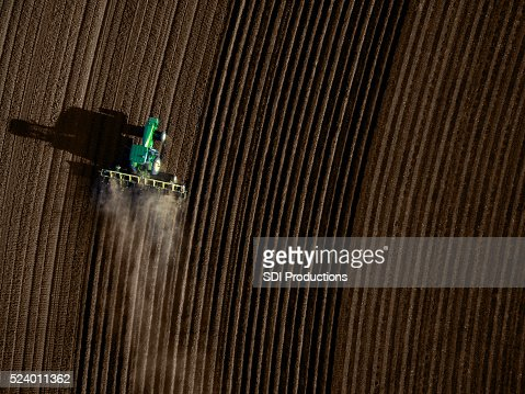 High angle view of tractor plowing a field