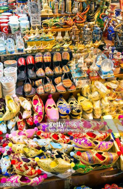 High Angle View Of Traditional Shoes And Antiques At Market Stall For Sale